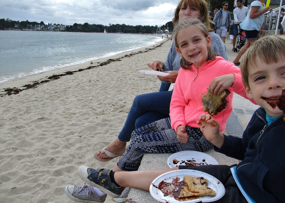 Eating crepes on the beach at Benodet